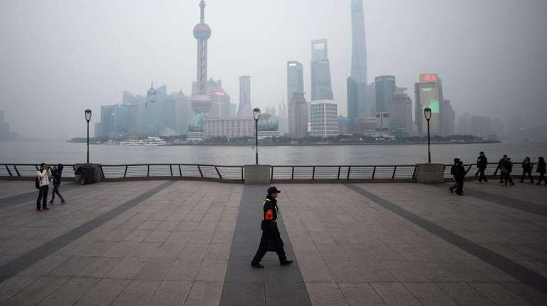 The Pudong financial district is in fog on
