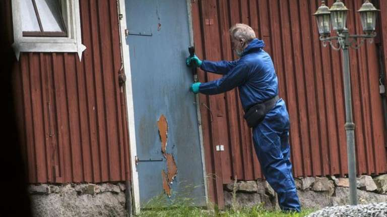 A Police forensic officer works at a property
