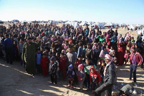 Syrian refugees inside the border wait to be