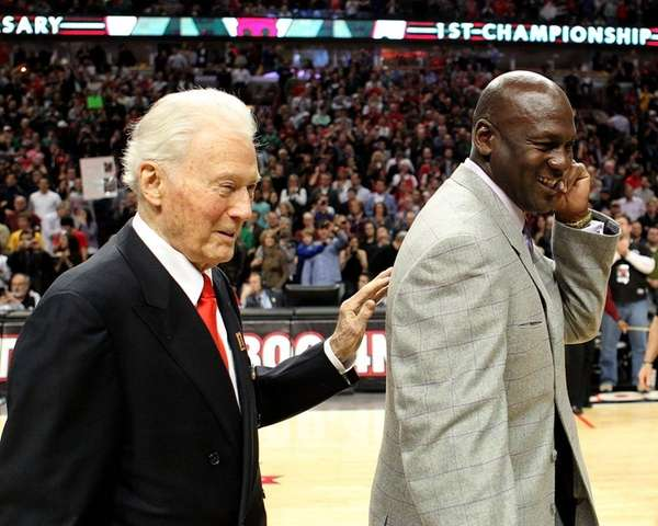 Bach, seen with Michael Jordan in 2011, helped