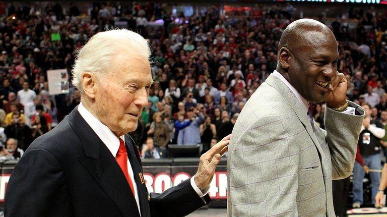 Bach, seen with Michael Jordan in 2011, helped