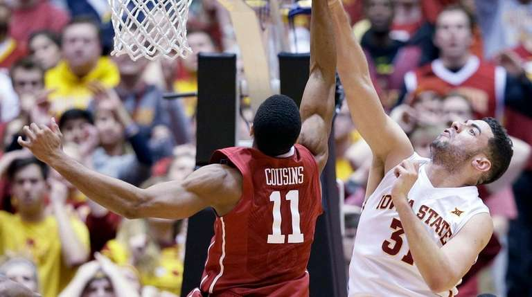 Iowa State forward Georges Niang, right, fights