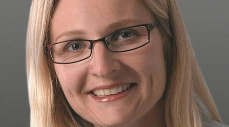 Toni Hoverkamp, of Aquebogue, has been promoted to
