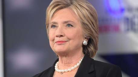 Democratic presidential hopeful Hillary Clinton looks on during