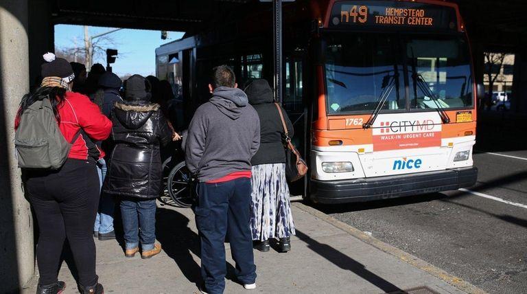 NICE bus riders wait at the Hicksville LIRR