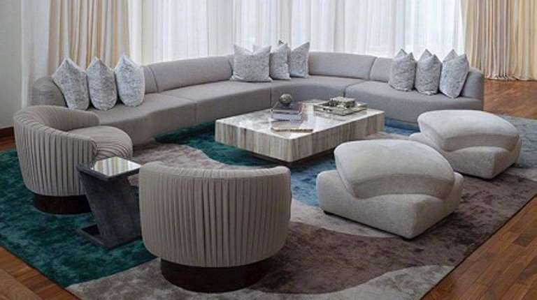 A custom sofa can help mirror the architectural