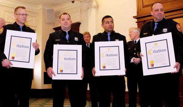 From left, police officers Peter Duvenhorst, Jason Dennington,