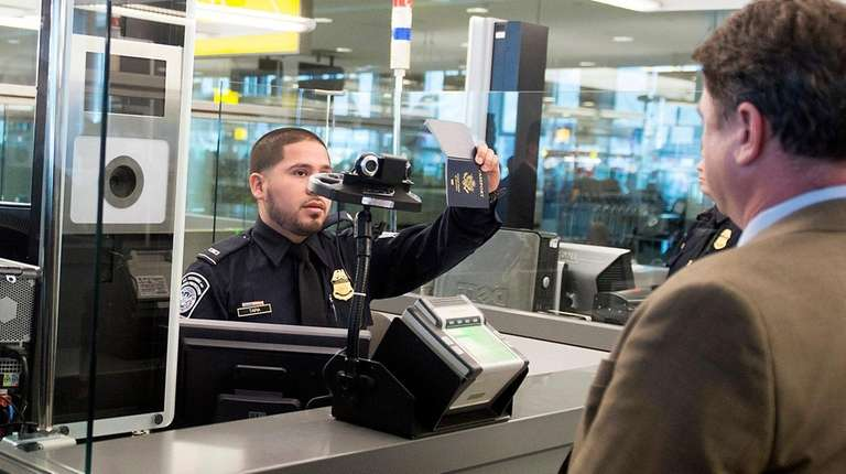 A Customs and Border Protection officer demonstrates the