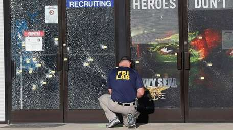 An FBI investigator investigates the scene of a