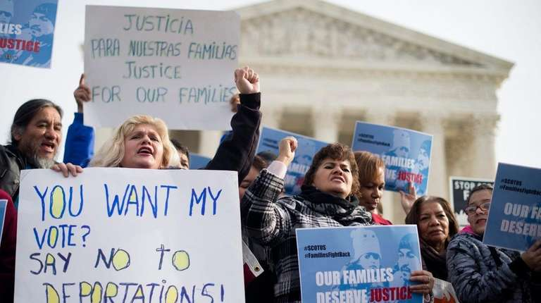 Immigration advocates rally outside the Supreme Court in