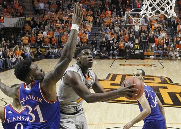 Oklahoma State guard Jawun Evans (1) goes