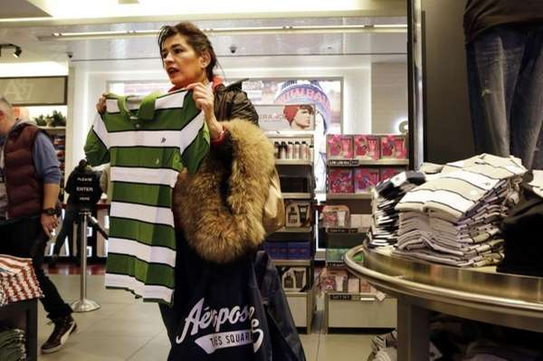 A woman shops in an Aeropostale clothing store