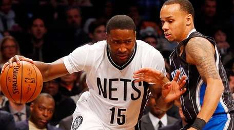 Donald Sloan of the Brooklyn Nets drives against