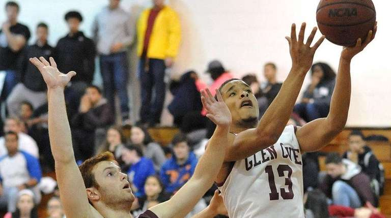 Glen Cove's Khalil Zachary drives past Brett Bennett