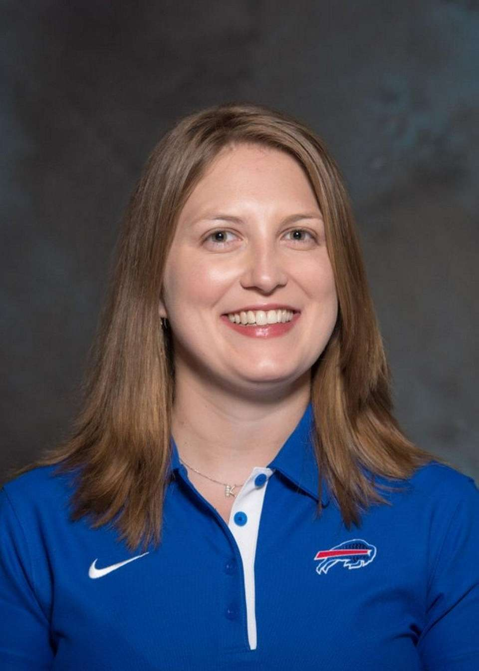 Smith became the first female full-time assistant coach