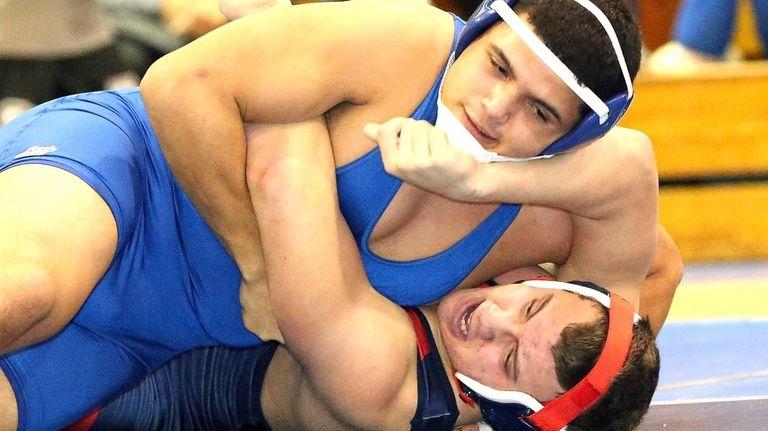 Long Beach's Mark Rivera wins his 220 pound