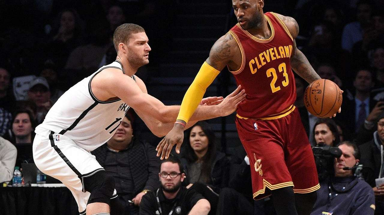 Brooklyn Nets center Brook Lopez defends Cleveland Cavaliers
