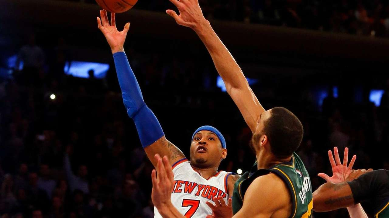 Carmelo Anthony puts up a shot late in