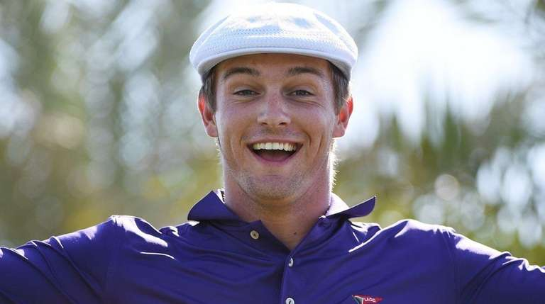 Bryson DeChambeau reacts after teeing off on