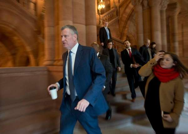 New York City Mayor Bill de Blasio walks