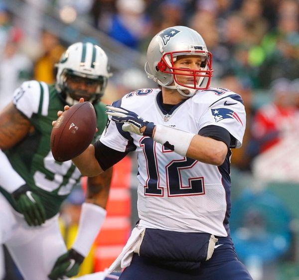 New England Patriots quarterback Tom Brady (12) throws