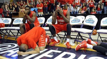 Stony Brook players react to a 51-50 loss