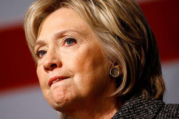 Democratic presidential candidate Hillary Clinton pauses while speaking