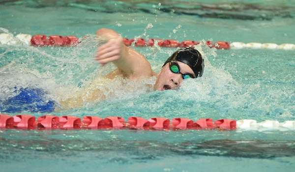 Half Hollow Hills' Justin Chang swims the