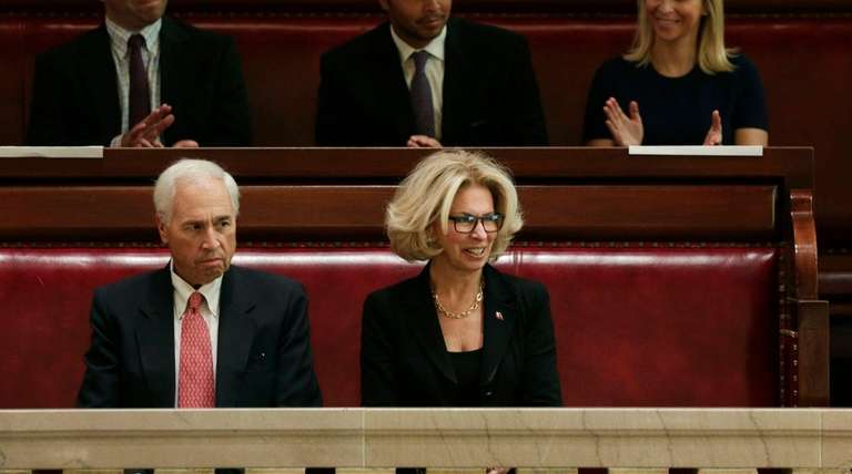 Janet DiFiore sits with her husband, Dennis Glazer,