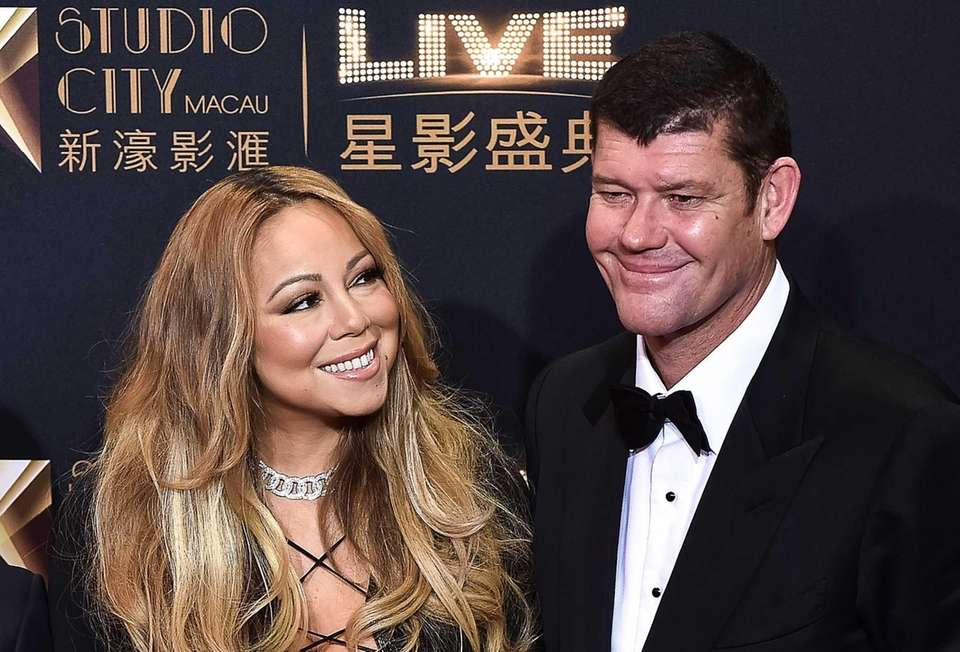 U.S. singer Mariah Carey looking at fiance and