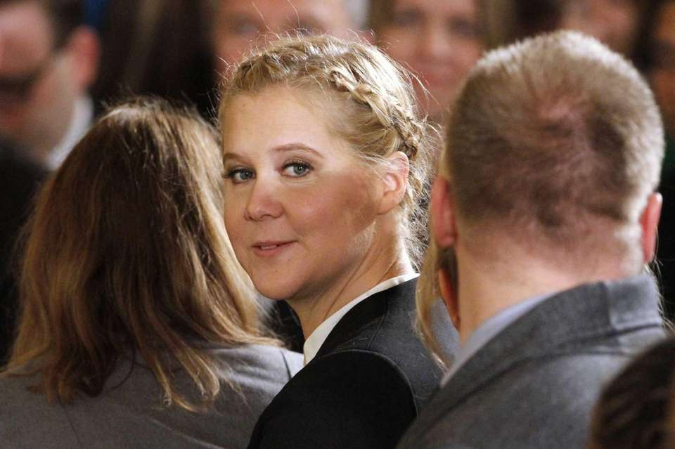 Actress and stand-up comedian Amy Schumer sits in