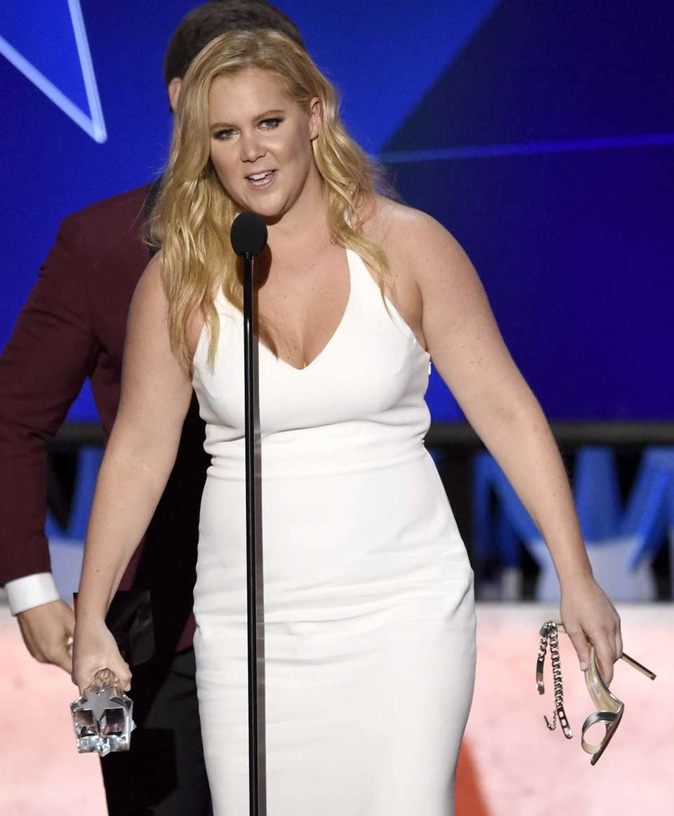 Amy Schumer accepts the award for best actress