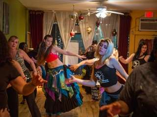 Students take a dance class at Tribal Dance