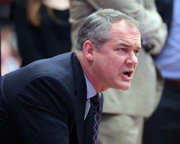 Stony Brook coach Steve Pikiell talks to his
