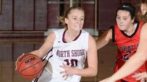 North Shore's Kelly Johansen (10) drives into the