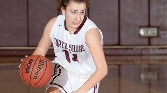 North Shore's Gabrielle Zaffiro (13) brings the ball