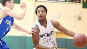 Westbury's Darius Young moves to the basket during