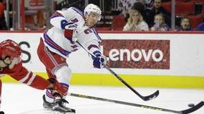 New York Rangers' Ryan McDonagh shoots and scores