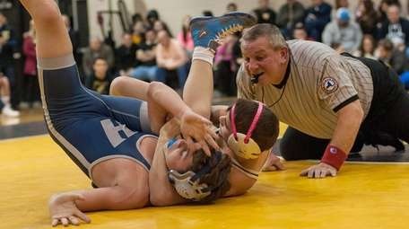 Wantagh's Justin Vines (right rear), goes up against