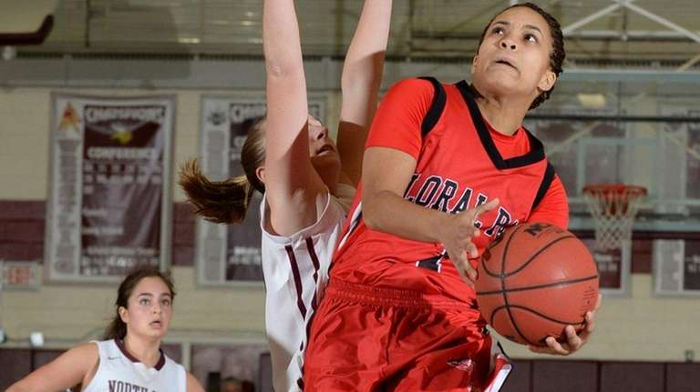 Floral Park's Kaela Hilaire (1) goes up for