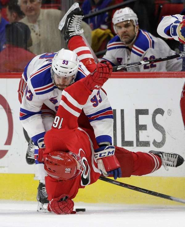 The Rangers' Keith Yandle puts Carolina's Elias Lindholm