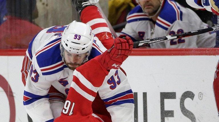 The Rangers' Keith Yandle puts Carolina's Elias Lindholm