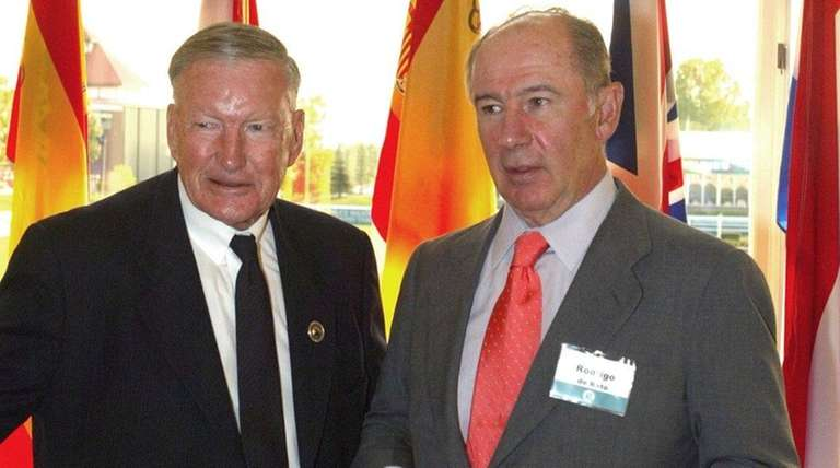 ATCO Co. Chairman Ron Southern, left, talks with