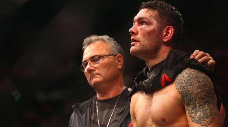 Chris Weidman looks on after being defeated by