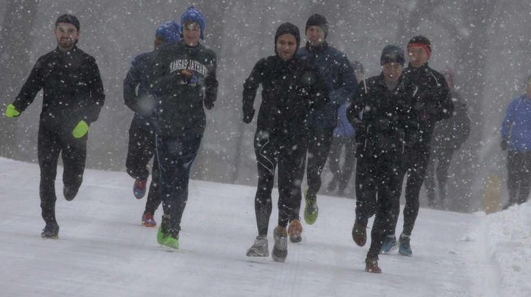 Joggers run through Central Park in Manhattan during