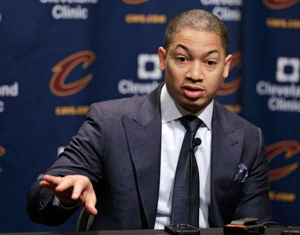 Cleveland Cavaliers coach Tyronn Lue answers questions during