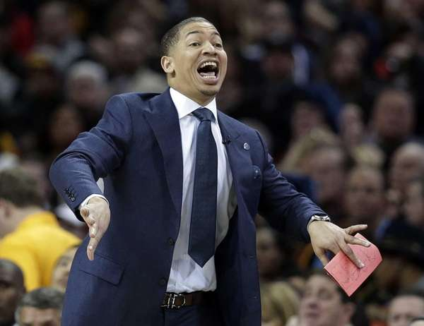 Cleveland Cavaliers head coach Tyronn Lue yells to
