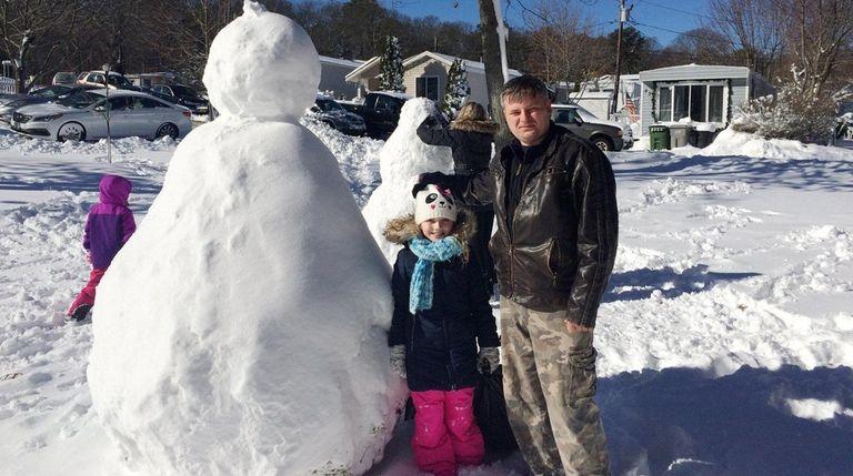 Krysztof Blaszczyk, 39, and his daughter Julia, 8,