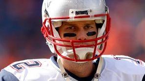 Tom Brady #of the New England Patriots warms