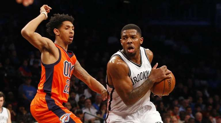 Joe Johnson of the Brooklyn Nets drives to